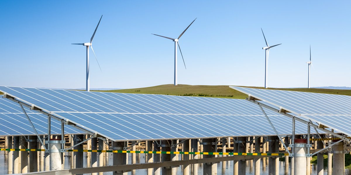 Solar panels and wind turbines, like the ones used to power eco-friendly websites